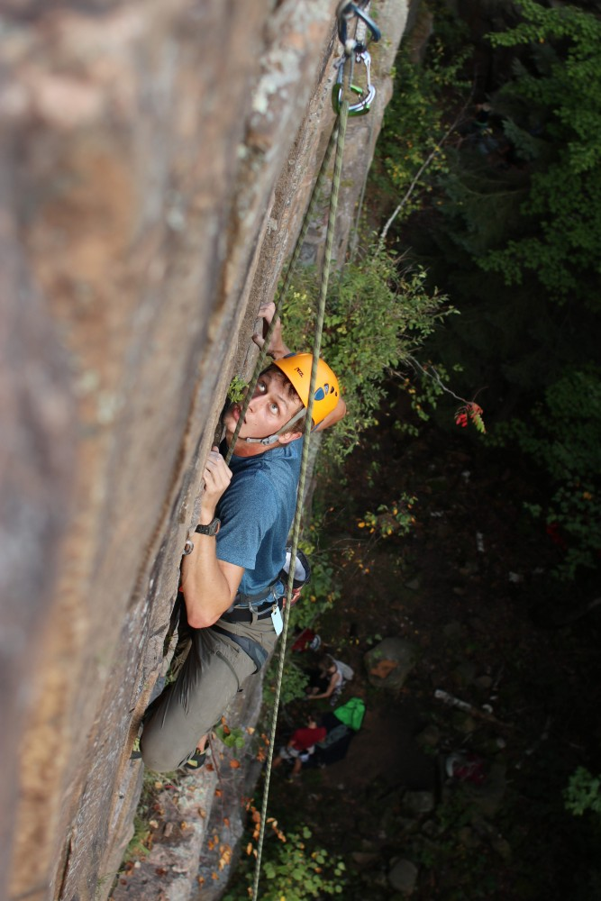 A climber ascends a route during his first outdoor session in Minnesota on Sept. 15 at Robinson Park in Sandstone, Minnesota.