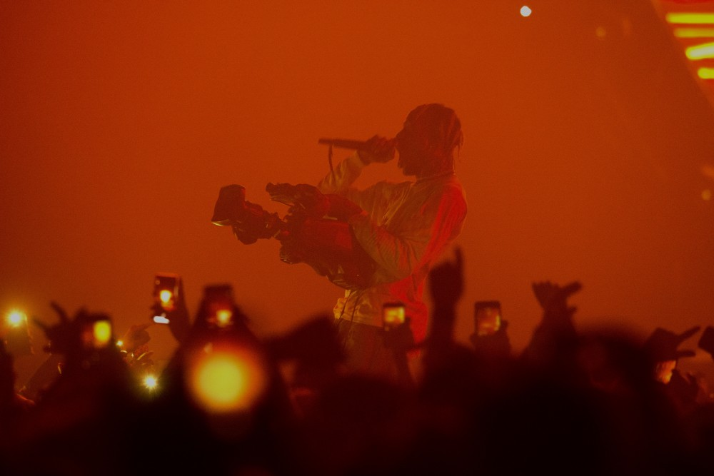 Rapper Travis Scott grabs a video camera during his show at Target Center on Saturday, Dec. 8 in Minneapolis.