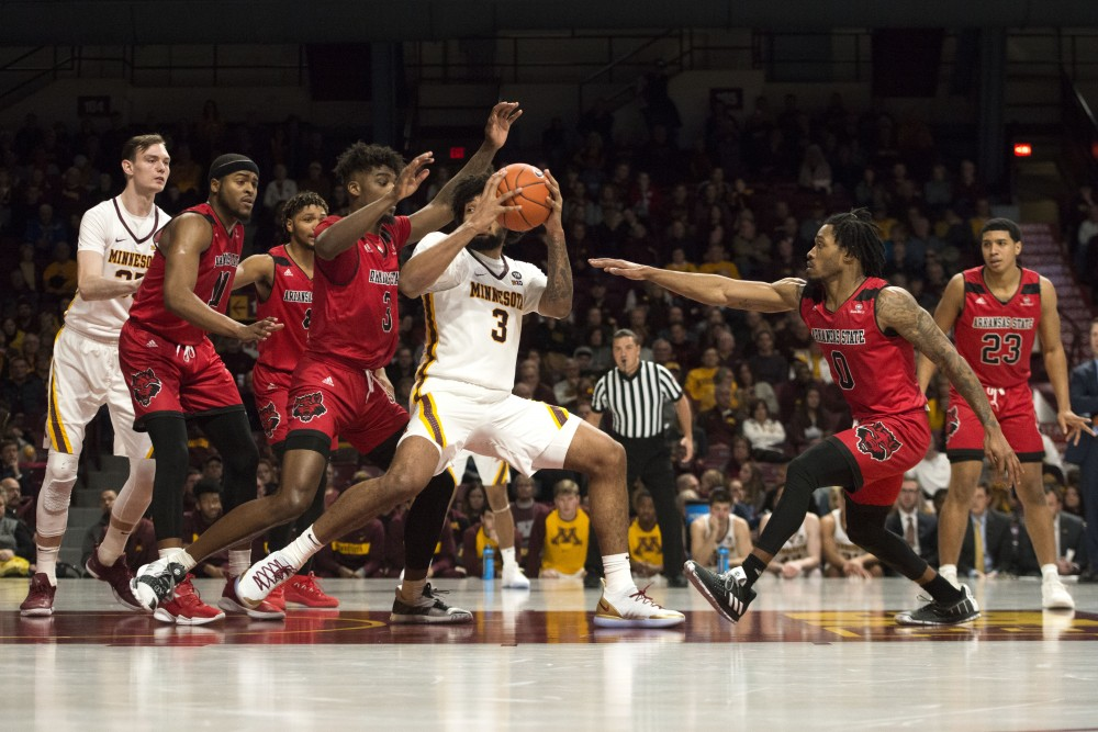 Senior forward Jordan Murphy jumps for the basket during the game against Arkansas State on Saturday, Dec. 8 at Williams Area.