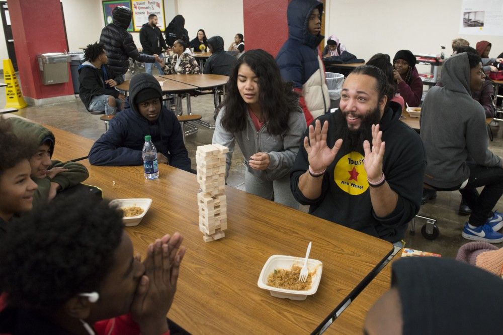 Community Outreach team member Mark Woods plays a game of Jenga with students at Patrick Henry High School  on Friday, Dec. 7. Woods sees him self as a