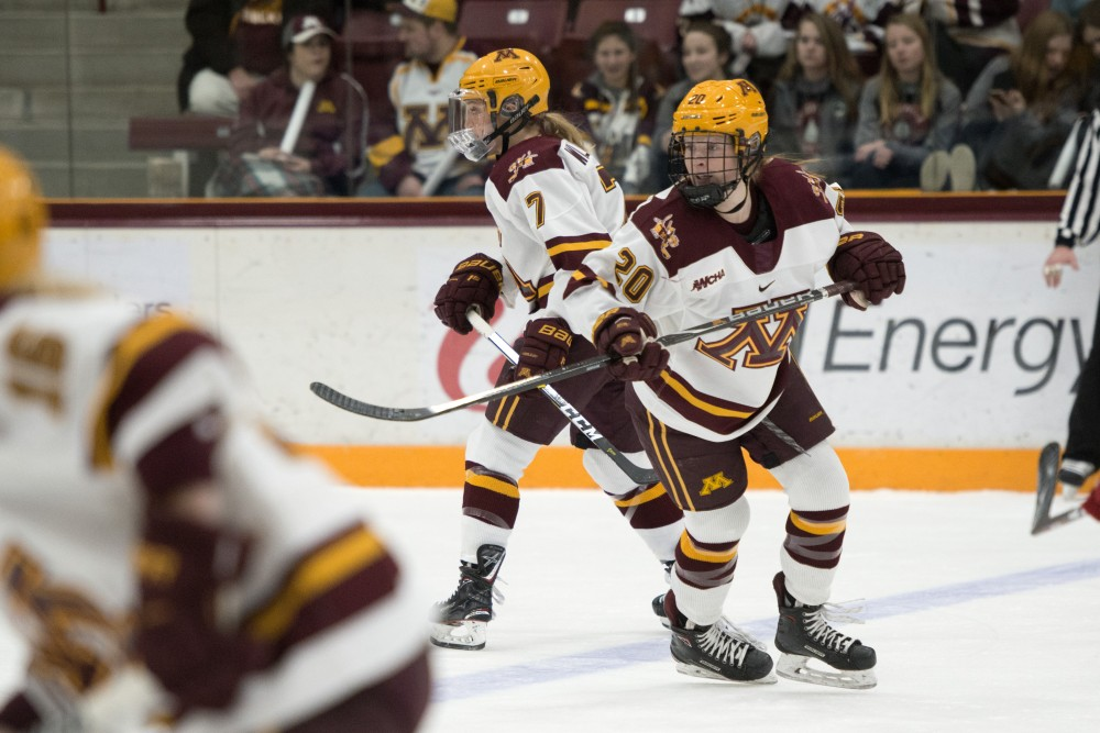 Junior forward Alex Woken eyes the puck during the game against Wisconsin on Jan. 18, 2019 at Ridder Arena.