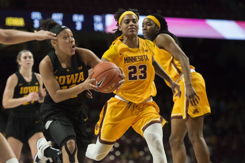 Redshirt senior Kenisha Bell chases after the ball on Monday, Jan. 14 at Williams Arena. The Gophers lost to the Hawkeyes 81-63.