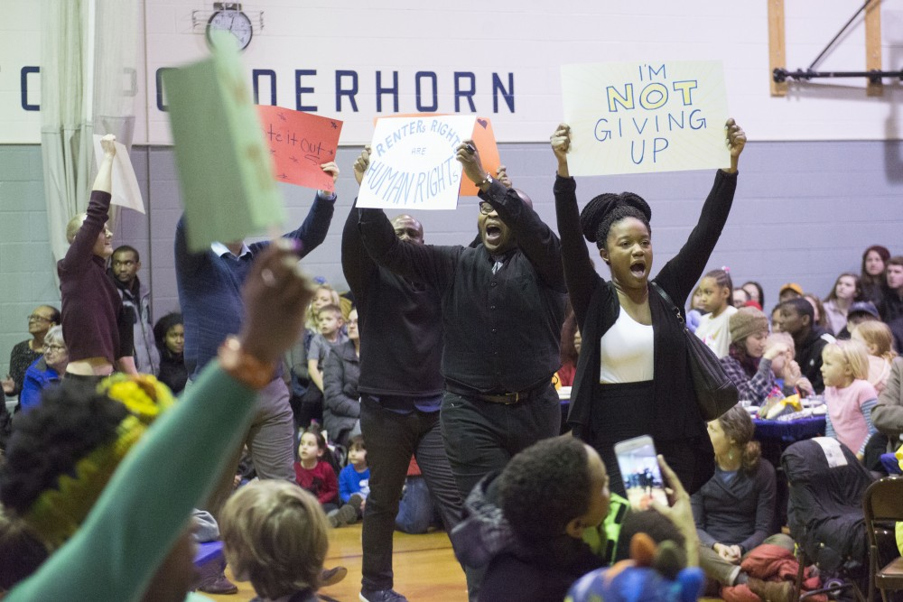 Rajané Katurah Brown leads a protest on Monday, Jan. 21 at the Powderhorn Recreation Center in Minneapolis. The 21st annual celebration of the Rev. Dr. Martin Luther King Jr., held by the Seward Co-op, drew around 250 people.