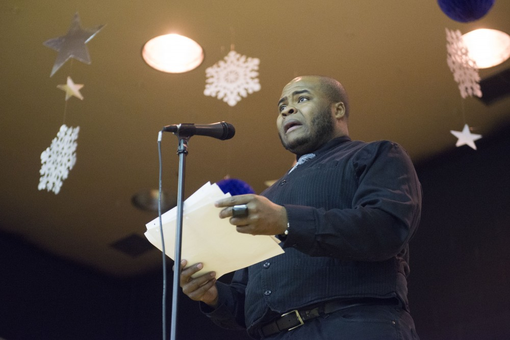 H. Adam Harris performs a piece on Monday, Jan. 21 at the Powderhorn Recreation Center in Minneapolis. The 21st annual celebration of the Rev. Dr. Martin Luther King Jr., held by the Seward Co-op, drew around 250 people.