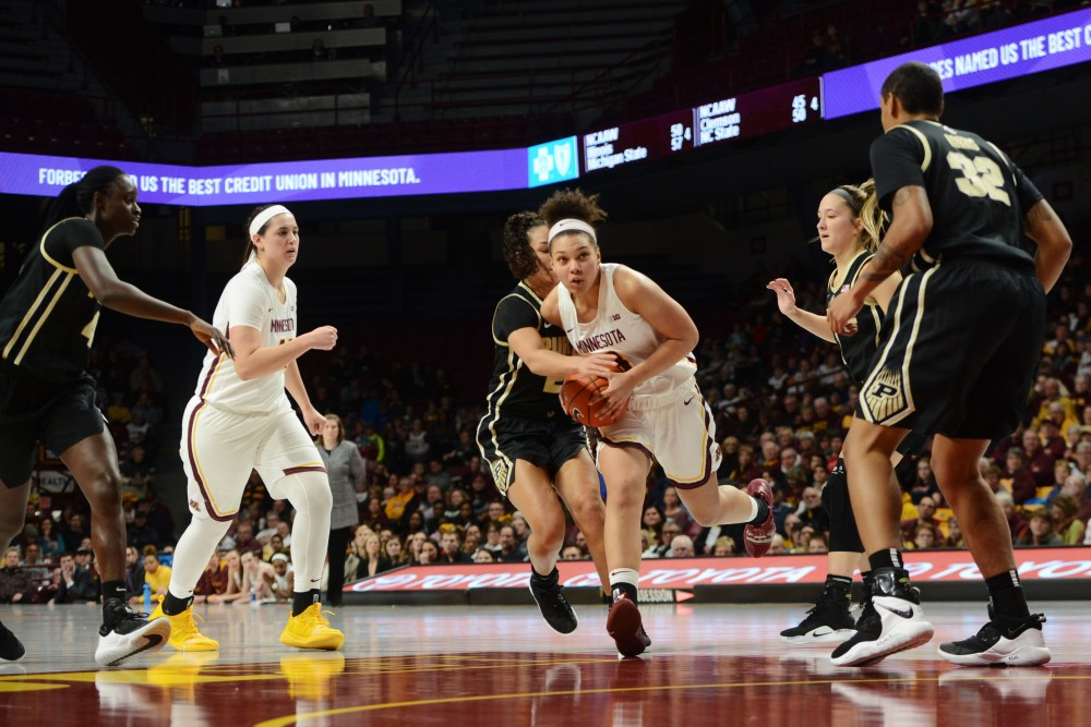 Sophomore Destiny Pitts runs through defenders toward the hoop during the game against Purdue on Thursday, Jan. 24.