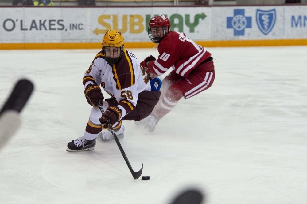 Freshman Sampo Ranta keeps the puck away from Wisconsin on Friday, Jan. 25 at 3M Arena at Mariucci.