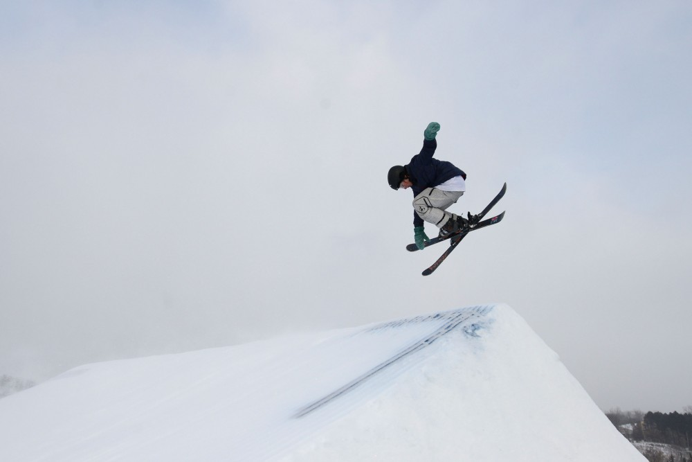 Jake Johnson, 15, grabs the tip of his skis after taking off from a large jump at Buck Hill on Saturday, Jan 26.