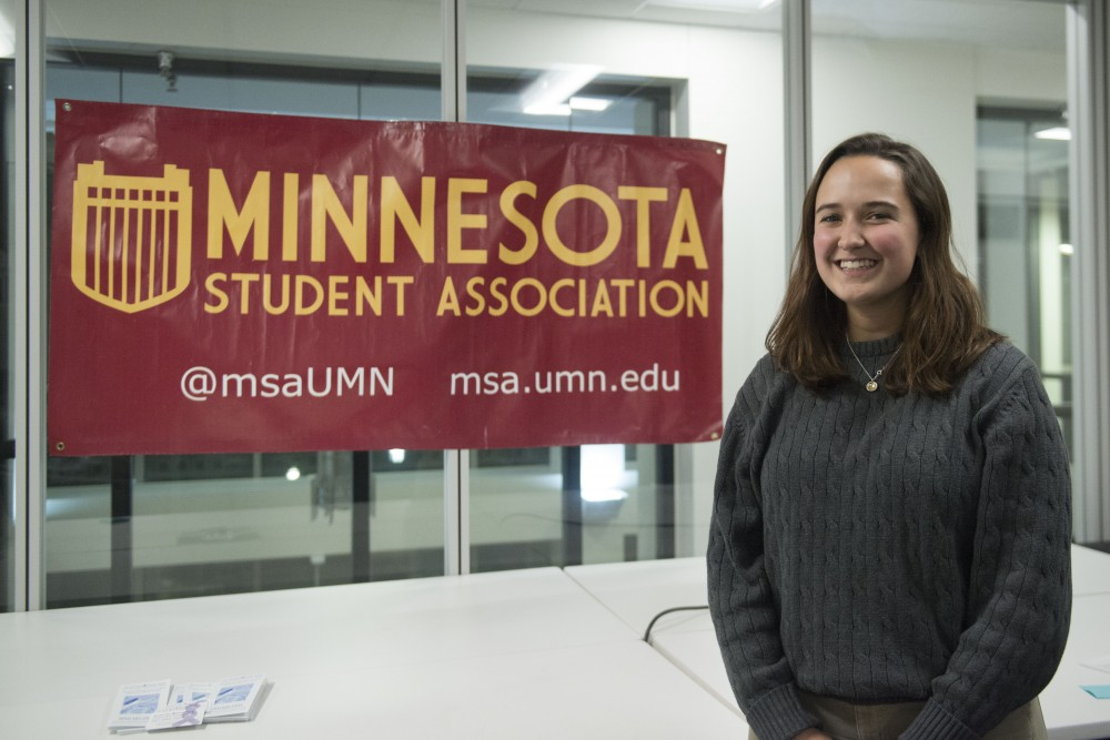 Meara Cline, Minnesota Student Association sexual assault task force chair, stands in the MSA room on Thursday, Jan. 24 at the Student Union. Cline helped facilitate a vigil Thursday evening held for sexual assault survivors and a comment writing bank for the proposed Title IX changes.