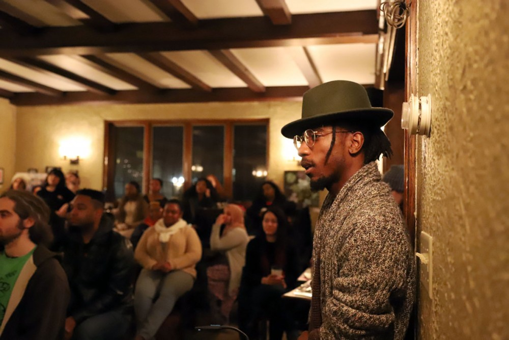 Keno Evol listens to the poetry reading at Bordertown Coffee in Minneapolis on Friday, Jan. 25.