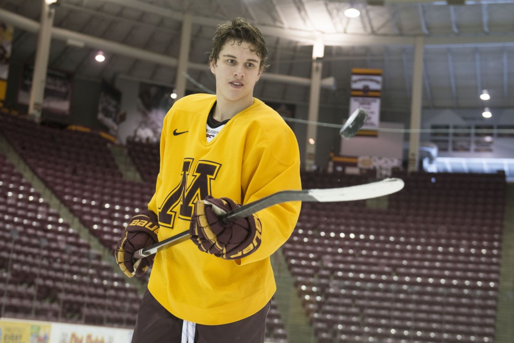 Freshman Blake McLaughlin plays with the puck after practice at 3M Arena at Mariucci on Tuesday, Jan. 29.