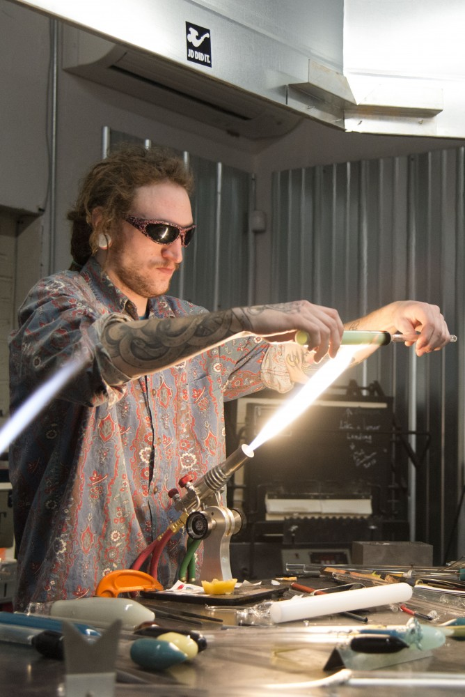 Mitchell Carlson works on a glass piece on Saturday, Jan. 26 at Legacy Glassworks in Minneapolis.