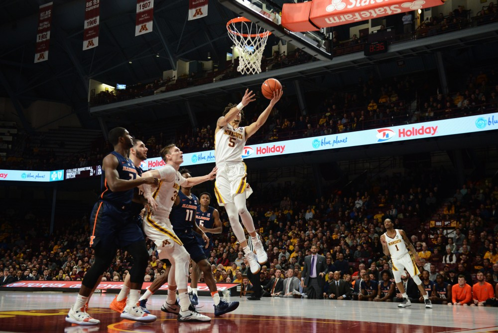 Junior Amir Coffey lays the ball in at Williams Arena on Wednesday, Jan. 30.