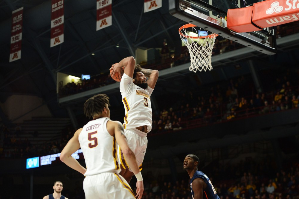 Senior Jordan Murphy winds up for the tomahawk dunk at Williams Arena on Wednesday, Jan. 30.