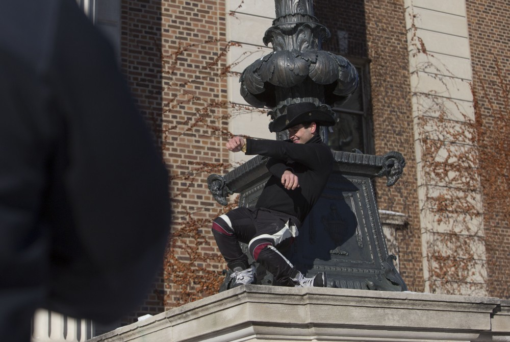Cooper Patch dances outside of Northrop as his friend Jon Taffe records him for a skate video on Wednesday, Jan. 31 in Minneapolis.