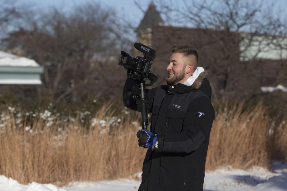Advertising student Jon Taffe records a friend to make a skate video while he has the day off classes due to cold weather on Jan. 31.