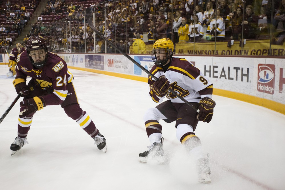 Forward Sammy Walker eyes the puck during the game against the University of Minnesota Duluth on Sunday, Oct. 7, 2019 at Mariucci Arena.