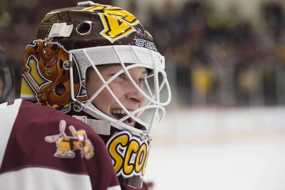 Goaltender Sydney Scobee smiles from the bench at Ridder Arena on Saturday, Feb. 2.