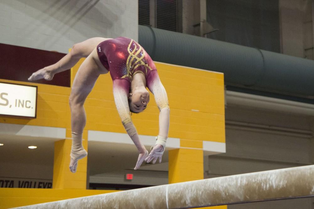 Sophomore Ona Loper performs on the balance beam on Saturday, Feb. 2 at Maturi Pavilion.