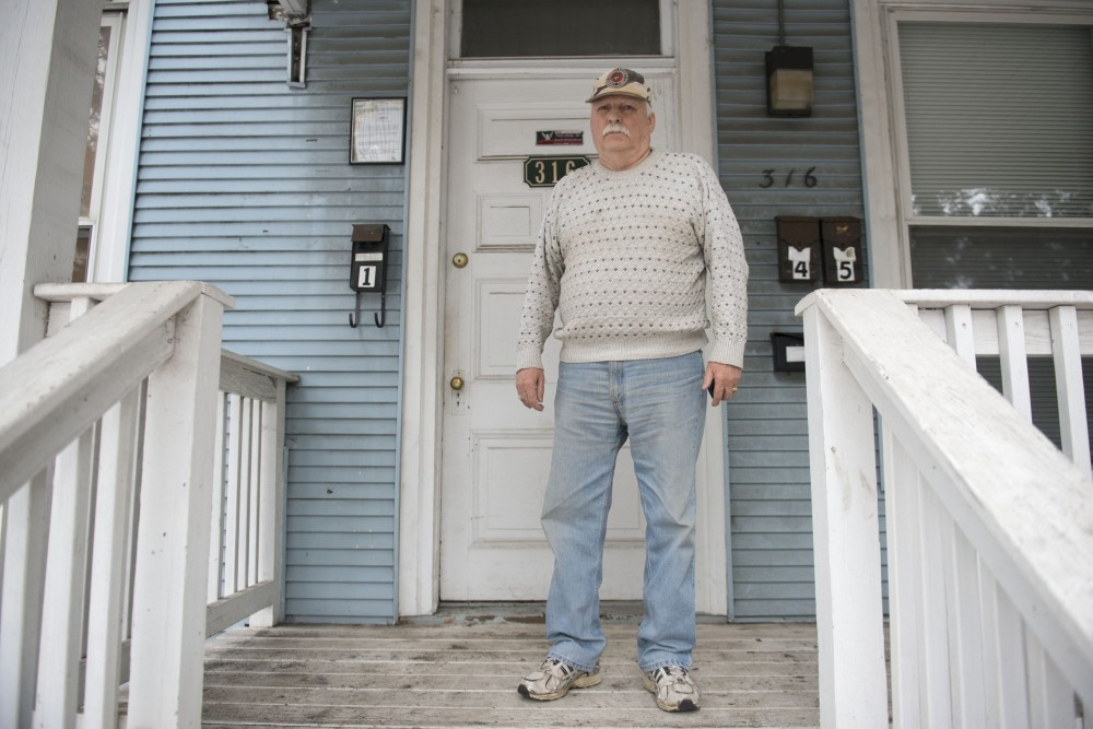 Thomas Magnon poses for a portrait on his front porch near Dinkytown on Monday, Feb. 4. Magnon and the other residents of several properties on the 1200 block of 4th Street SE, many of which are students, will be forced to move out on Feb. 28.