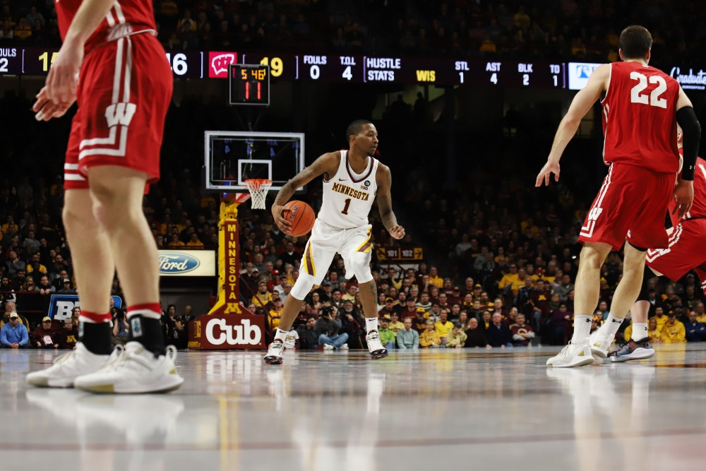 Dupree McBrayer dribbles the ball during the game against Wisconsin on Feb. 7 at Williams Arena.