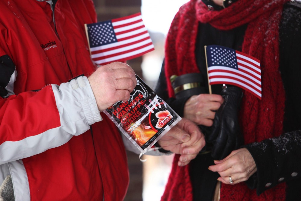 Charlie and Joy Kling open a package of hand warmers given out by Amy Klobuchar's staff before her announcement on Sunday, Feb. 10 at Boom Island Park in Northeast Minneapolis.