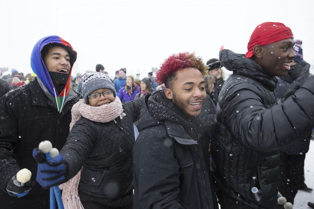 Members of the North High School and Patrick Henry High School drumline dance before their performance at Amy Klobuchar's presidential bid event on Sunday, Feb. 10 at Boom Island Park in Minneapolis.
