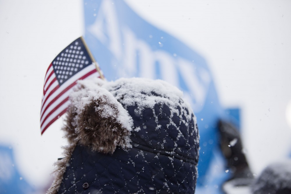 Snow accumulated on the heads and hats of many as Amy Klobuchar announced her bid for the presidency on Sunday, Feb. 10 at Boom Island Park in Minneapolis.