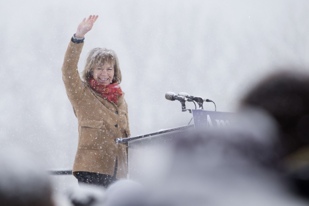 Sen. Tina Smith, D-Minn., waves to those who came out to support Amy Klobuchar's presidential bid on Sunday, Feb. 10 at Boom Island Park in Minneapolis.