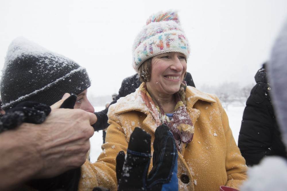 Sen. Amy Klobuchar, D-Minn., meets fans on her way out after announcing her presidential bid on Sunday, Feb. 10 at Boom Island Park in Minneapolis.