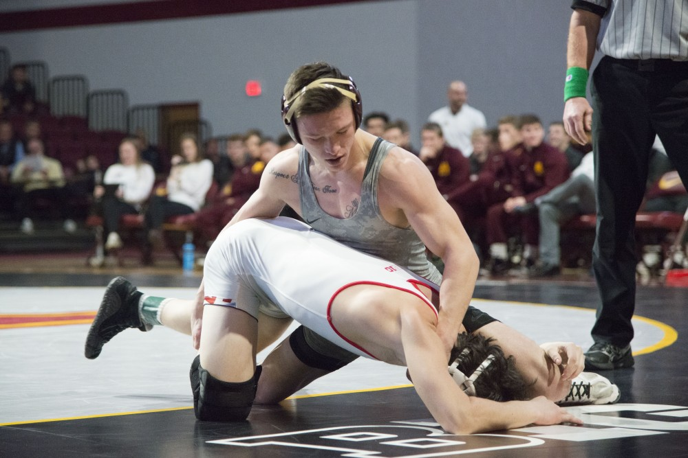 Junior Mitch McKee at 141 competes during the match against the University of Maryland on Sunday, Feb. 10 at Maturi Pavilion.