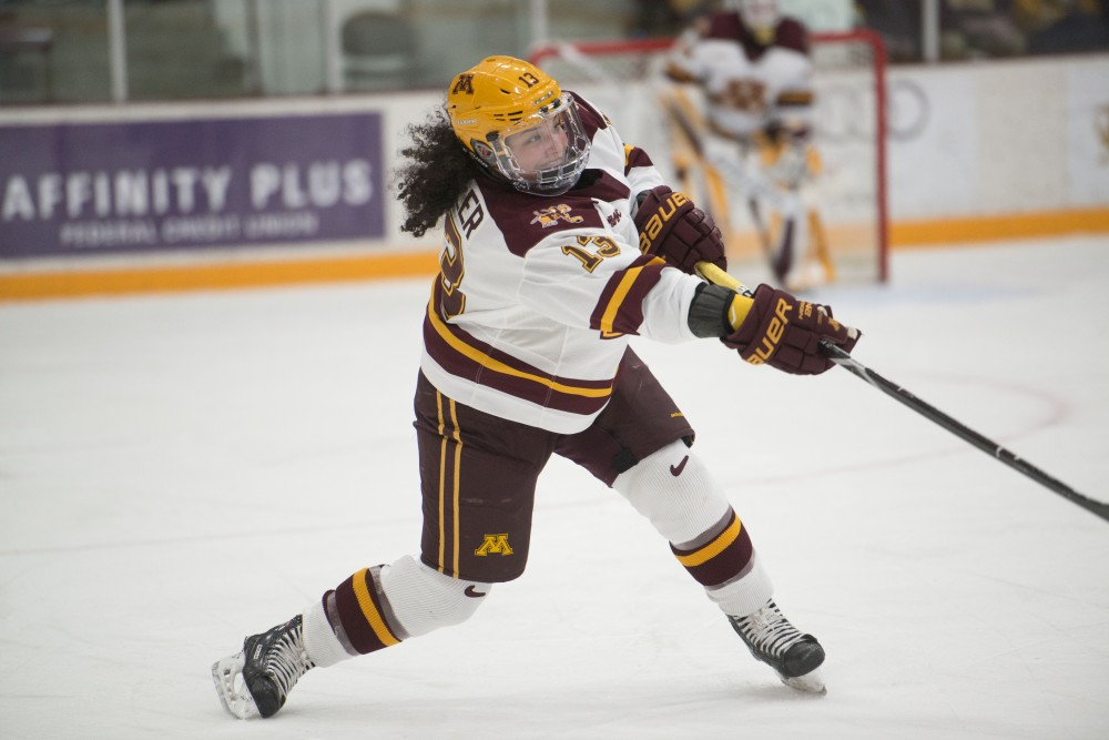 Freshman Crystalyn Hengler passes the puck on Friday, Jan. 18 at Ridder Arena. The Gophers lost to the Wisconsin Badgers 2-1.