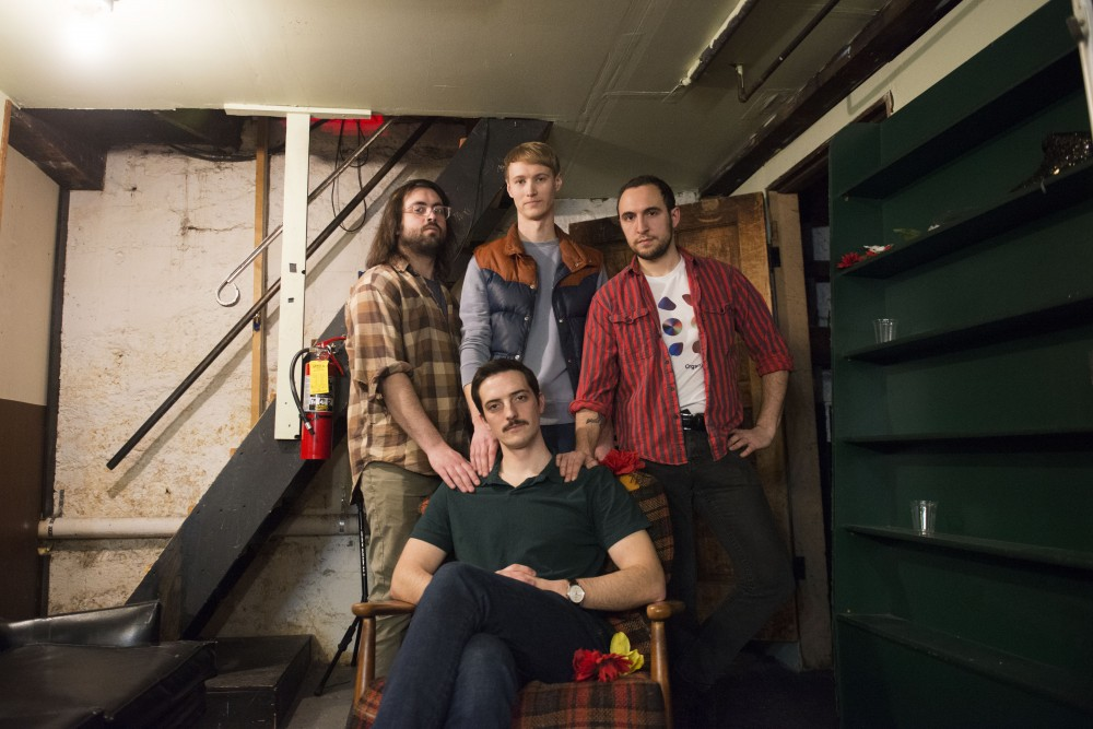 Nick Baker, Noah Welter, Chase Wackerfuss and Andy Engstrom of Fragile Canyons pose for a portrait on Saturday, Feb. 16 at Bryant-Lake Bowl and Theater in Minneapolis. The show brought in around 50 people Saturday night.