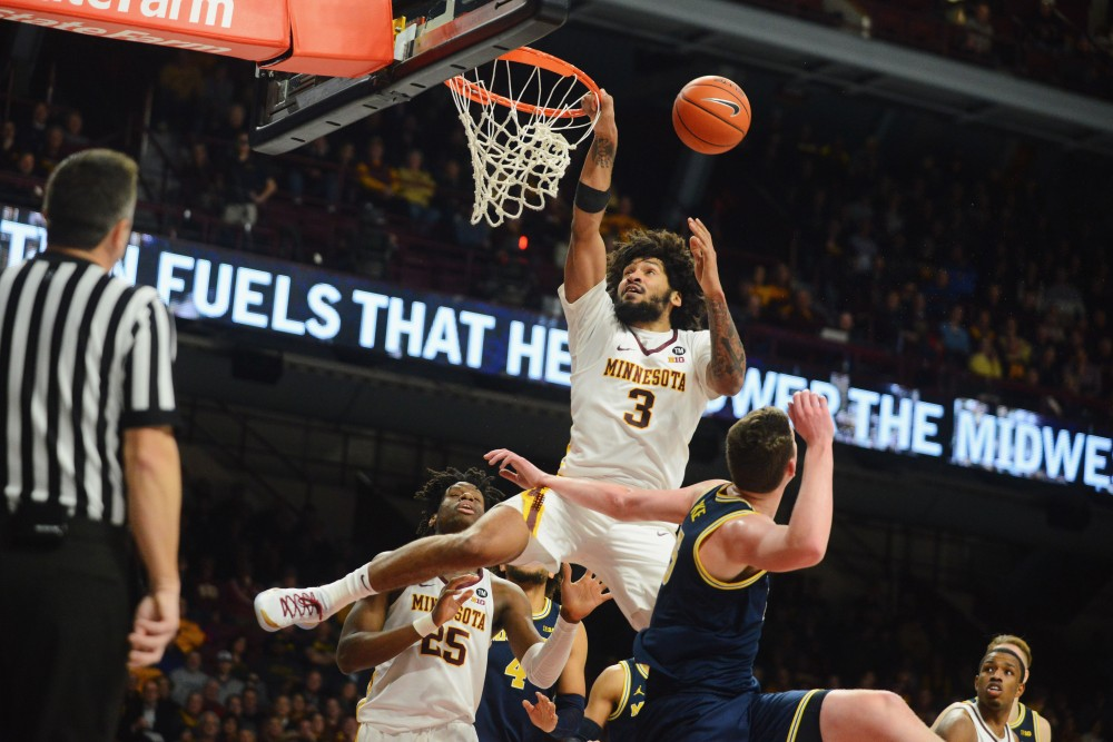 Senior Jordan Murphy goes to dunk the ball on Thursday, Feb. 21 at Williams Arena in Minneapolis.