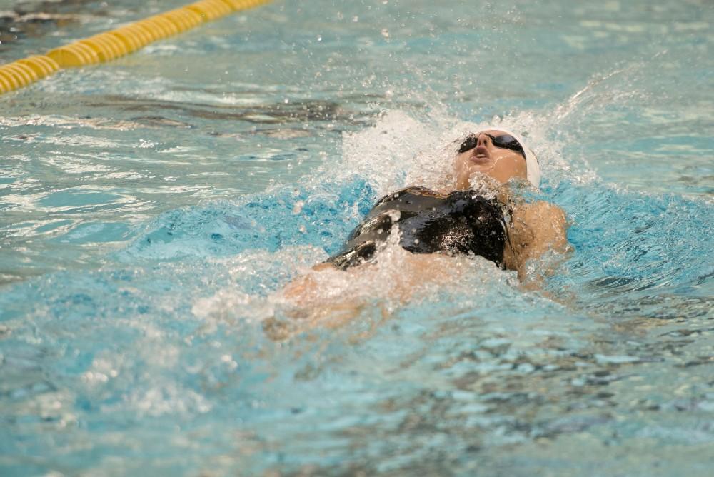 Junior Chantal Nack competes in the women's 200 yard backstroke at the Jean K. Freeman Aquatics Center on Saturday, Jan. 27, 2018.
