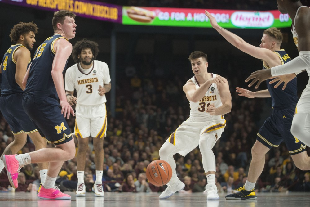 Brock Stull loses control of the ball on Thursday, Feb. 21 at Williams Arena in Minneapolis. The Gophers lost to Michigan 69-60.