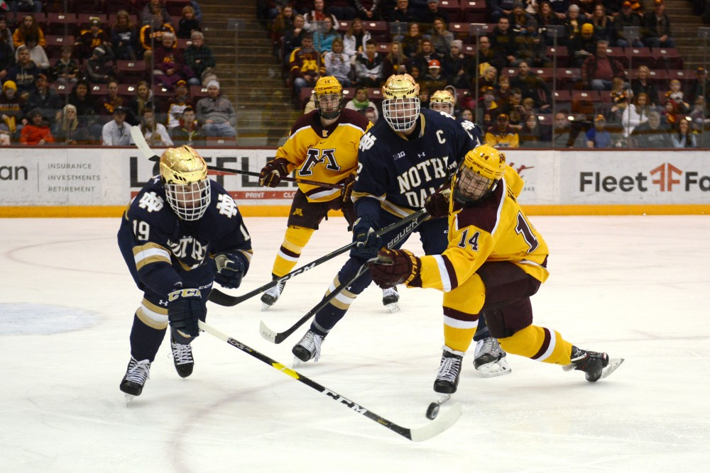 Freshman Garrett Wait stretches out to grab the puck on Saturday, Feb. 23 at Mariucci Arena. The Gophers beat Notre Dame 2-1.