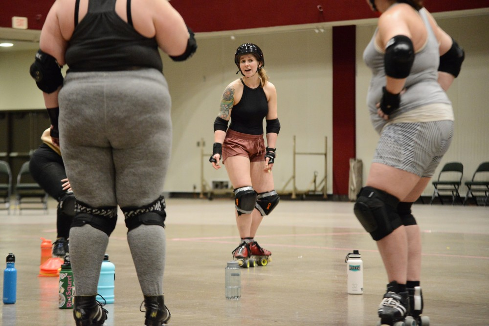 The Debu-Taunts team listens to a trainer during practice on Sunday, Feb. 24 at Roy Wilkins Auditorium in St. Paul. The Debu-Taunts training program of the Minnesota RollerGirls meets every Sunday to teach developing skaters about the world of derby.