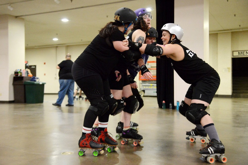 Members of the Debu-Taunts team practice on Sunday, Feb. 24 at Roy Wilkins Auditorium in St. Paul. The Debu-Taunts training program of the Minnesota RollerGirls meets every Sunday to teach developing skaters about the world of derby.