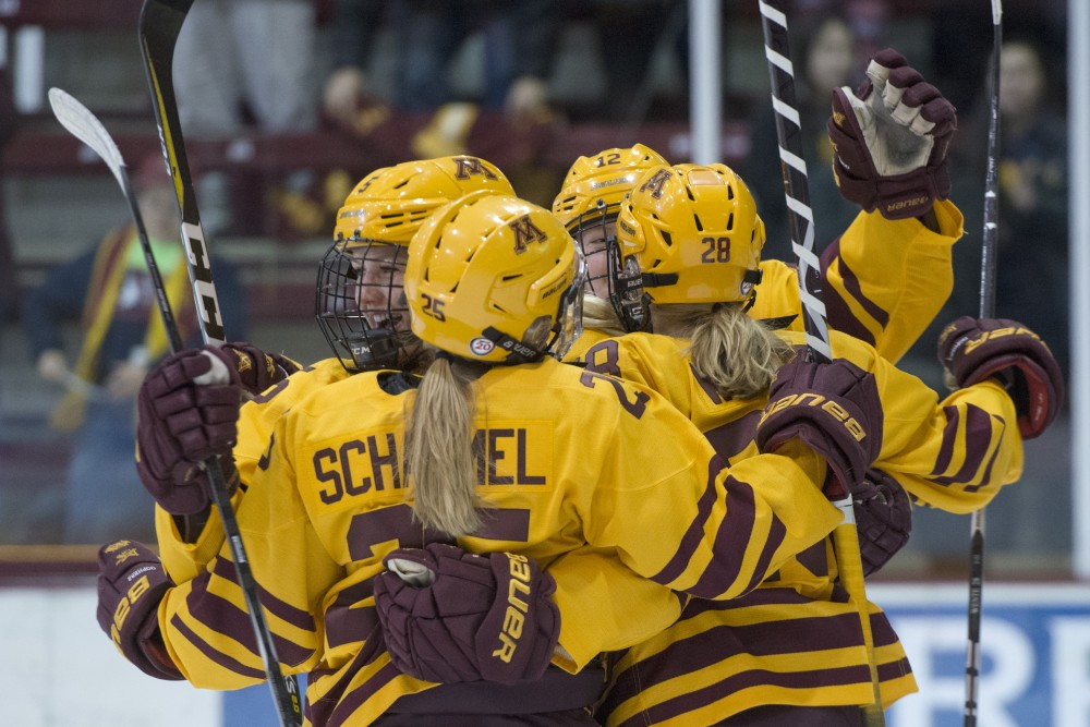 Members of the team celebrate after a goal on Friday, Dec. 7, 2018 at Ridder Arena.