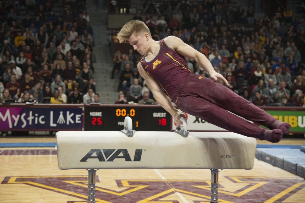 Sophomore Shane Wiskus competes in the pommel horse at the Maturi Pavilion on Saturday, Jan. 26.