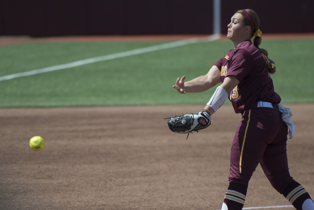 Sophomore Amber Fiser pitches during a game against Nebraska at Jane Sage Cowles Stadium on Saturday, April 21, 2018.