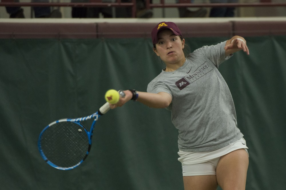 Senior Caitlyn Merzbacher returns the ball during her singles match against the University of Montana at the Baseline Tennis Center on Saturday, Feb. 2.