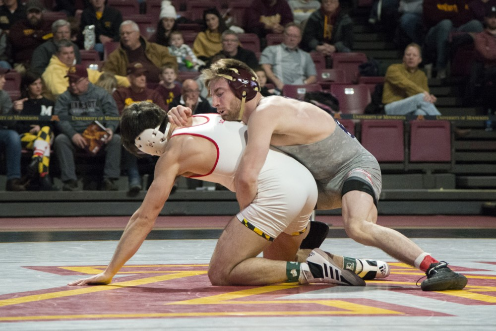 Redshirt junior Carson Brolsma competes during the match against the University of Maryland on Sunday, Feb. 10, 2019 at Maturi Pavilion.