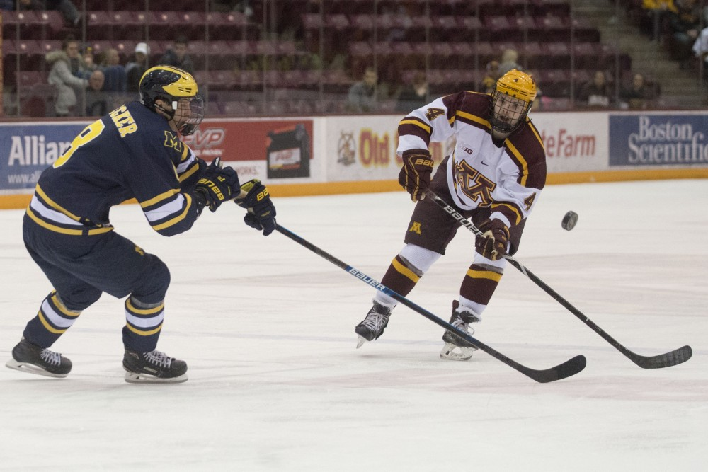 Freshman Ben Brinkman passes the puck on Friday, March 8 at Mariucci Arena in Minneapolis. The Gophers beat Michigan 3-2 in overtime.