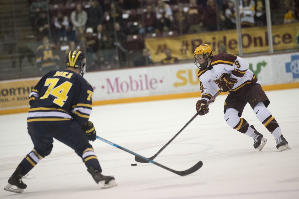 Freshman Sammy Walker skates with the puck on Friday, March 8 at Mariucci Arena in Minneapolis. The Gophers beat Michigan 3-2 in overtime.