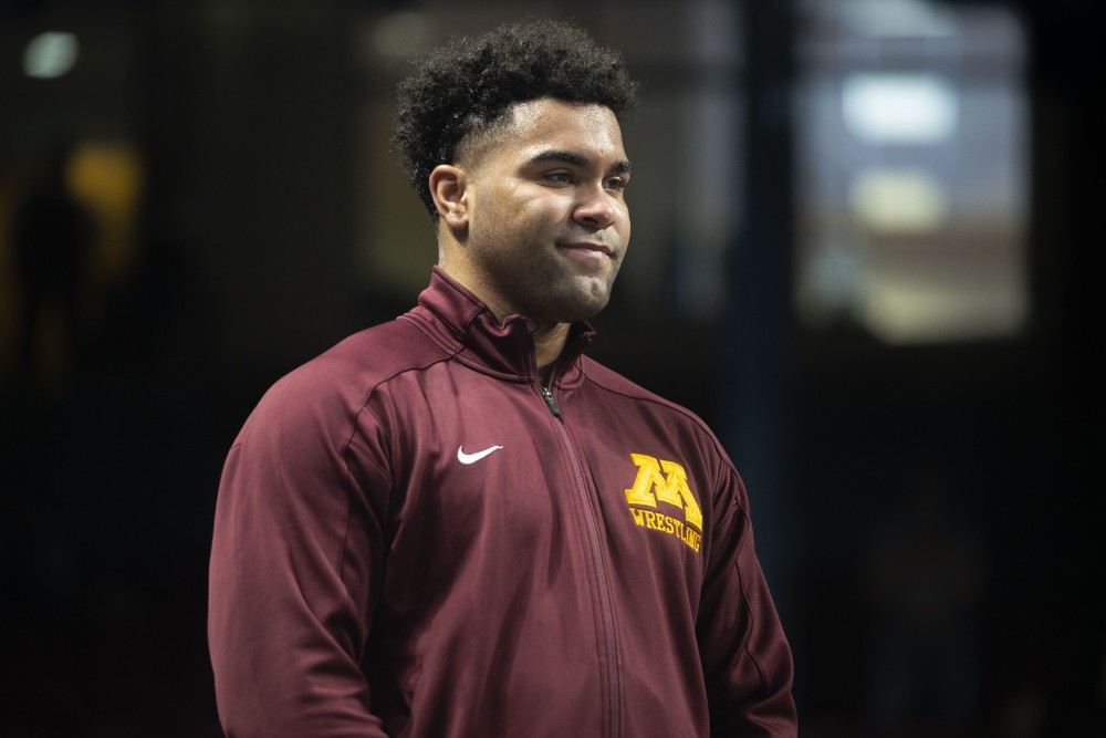 Freshman Gable Steveson stands on the podium after receiving his second place award on Sunday, March 10 at Williams Arena in Minneapolis. Steveson lost the match against Anthony Cassar of Penn State 4-3.