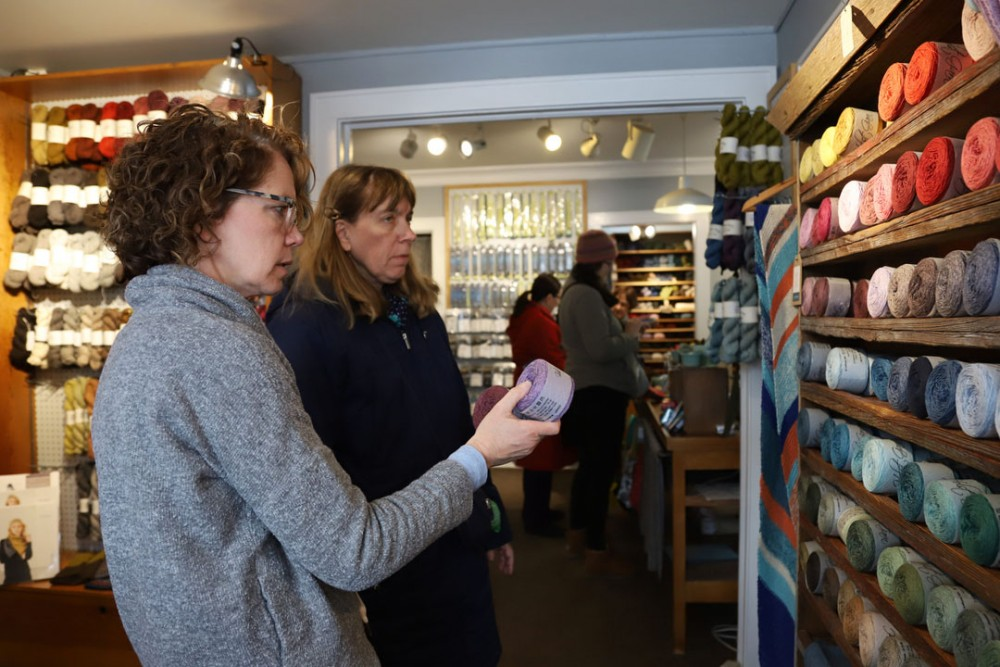<p>Shelly Sheehan helps Jane Tracy pick out a collection of yarn to knit at The Yarnery in Minneapolis March 9.</p>