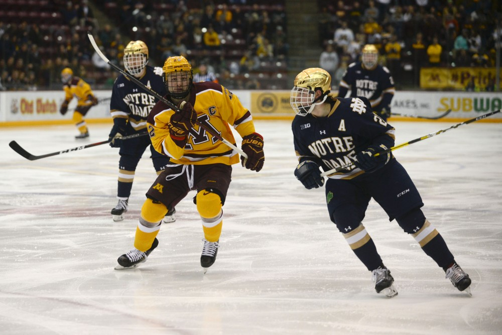 <p>Senior Tyler Sheehy skates toward the puck on Saturday, Feb. 23 at Mariucci Arena. The Gophers beat Notre Dame 2-1.</p>