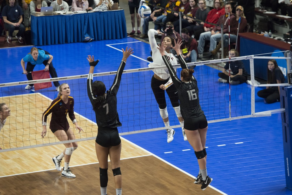 Outside hitter Alexis Hart jumps to spike the ball at the Maturi Pavilion on Friday, Dec. 7, 2019. The Gophers were upset by Oregon, losing 3 sets to 1.