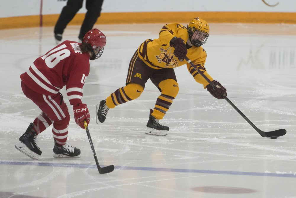 Defender Emily Brown looks to pass the puck up the ice at Ridder Arena on Sunday, March 10. Wisconsin beat the Gophers 3-1 to win the 2019 WCHA Final Faceoff.